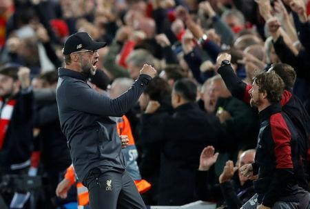 Soccer Football - Champions League - Group Stage - Group C - Liverpool v Paris St Germain - Anfield, Liverpool, Britain - September 18, 2018 Liverpool manager Juergen Klopp celebrates after Daniel Sturridge scores their first goal Action Images via Reuters/Carl Recine