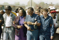 FILE - In this March 4, 1990, file photo, Coretta Scott King walks arm-in-arm with Southern Christian Leadership Conference President Joseph Lowery, second from right, in Selma, Ala., as marchers begin the final leg of their trek to the Alabama Capitol. The March 7, 2021, Selma Bridge Crossing Jubilee will be the first without the towering presence of John Lewis, as well as Lowery, the Rev. C.T. Vivian and attorney Bruce Boynton, who all died in 2020. (AP Photo/Dave Martin, File)