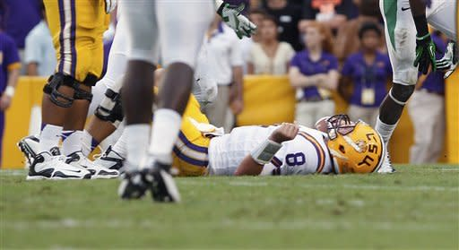 LSU quarterback Zach Mettenberger (8) lies on the ground after being sacked by North Texas during the first half of an NCAA college football game in Baton Rouge, La., Saturday, Sept. 1, 2012. (AP Photo/Bill Haber)