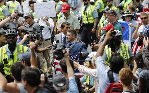 Jason Kessler, the organizer of the white rights protest, center, speaks to members of the media during the Unite the Right 2 rally in Washington, D.C - Credit: Bloomberg