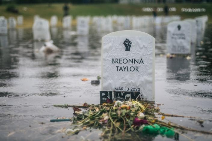 "<span class=""caption"">A temporary tombstone commemorating Breonna Taylor, shot dead by an officer in Louisville.</span> <span class=""attribution""><a class=""link rapid-noclick-resp"" href=""https://www.gettyimages.com/detail/news-photo/the-say-their-names-cemetery-floods-on-june-18-2020-in-news-photo/1221069749?adppopup=true"" rel=""nofollow noopener"" target=""_blank"" data-ylk=""slk:Brandon Bell/Getty Images"">Brandon Bell/Getty Images</a></span>"