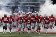 Ohio State players run on to the field for the start of their NCAA college football game against Nebraska Saturday, Oct. 24, 2020, in Columbus, Ohio. (AP Photo/Jay LaPrete)