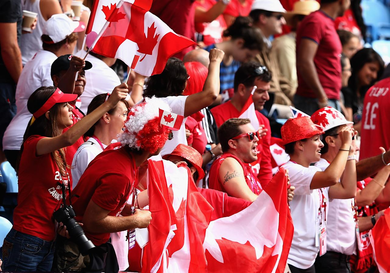 COVENTRY, ENGLAND - JULY 28:  Canadian fans show their support during the Women's Football first round Group F Match of the London 2012 Olympic Games between Canada and South Africa, at City of Coventry Stadium on July 28, 2012 in Coventry, England.  (Photo by Quinn Rooney/Getty Images)