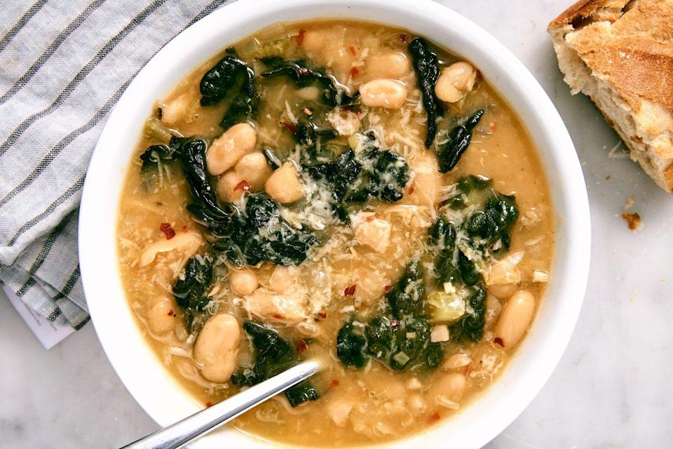 """<p>Your heart will melt just like the Parm.</p><p>Get the recipe from <a href=""""https://www.delish.com/cooking/recipe-ideas/a25647805/vegetarian-kale-soup/"""" rel=""""nofollow noopener"""" target=""""_blank"""" data-ylk=""""slk:Delish"""" class=""""link rapid-noclick-resp"""">Delish</a>.</p>"""