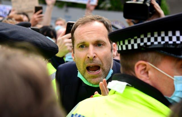 Petr Cech attempts to speak to fans protesting outside Stamford Bridge