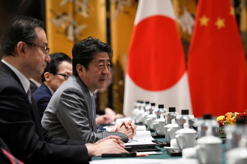 Japan's Prime Minister Shinzo Abe speaks at a bilateral meeting with China's Premier Li Keqiang during the 8th trilateral leaders' meeting between China, South Korea and Japan in Dujiangyan