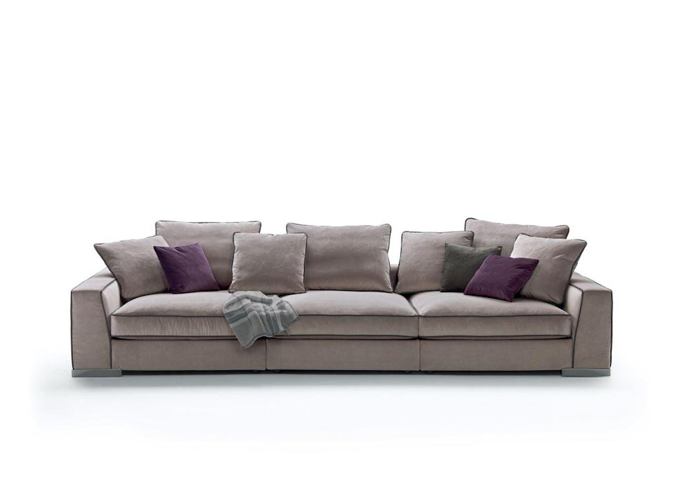 "<p>You can choose from tone-on-tone or contrasting piping to make this timeless and ultra-comfortable sofa standout as little or as much as you want. £3,038, <a href=""https://www.flexform.it/en/mood/products/sofas-sectional-sofas-ottomans/armand#gref"" rel=""nofollow noopener"" target=""_blank"" data-ylk=""slk:flexform.it"" class=""link rapid-noclick-resp"">flexform.it</a></p>"