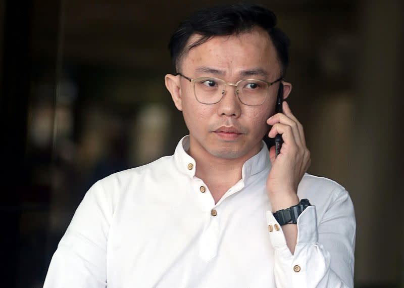 Tan Tong Han, owner of Black Tidings, leaves a court in Singapore