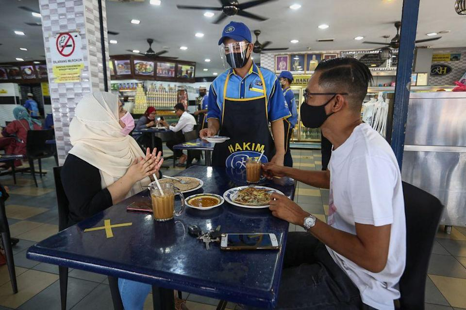 Patrons are seen dining in at Hakim Restaurant in Shah Alam February 10, 2021. — Picture by Yusof Mat Isa