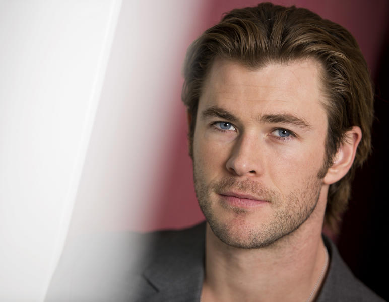 """In this Tuesday, Nov. 5, 2013 photo, Australian actor and star, Chris Hemsworth, of the upcoming film """"Thor: The Dark World,"""" poses for a portrait, in New York. Overseas, Disney's movie earned an impressive $109.4 million when it opened internationally last weekend. The Marvel sequel releases in theaters in the US on Friday, Nov. 8, 2013. (Photo by Brian Ach/Invision/AP)"""