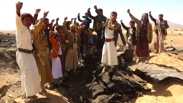 A video released by al-Huthi Military Media Office on February 15, 2020 shows Yemenis cheering at the site of the downing of a Saudi Tornado aircraft (AFP Photo/-)