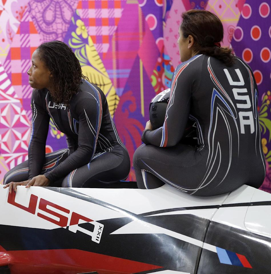 The team from the United States USA-1, piloted by Elana Meyers with brakeman Lauryn Williams, left, wait for scores after their first run during the women's two-man bobsled competition at the 2014 Winter Olympics, Tuesday, Feb. 18, 2014, in Krasnaya Polyana, Russia. (AP Photo/Dita Alangkara)