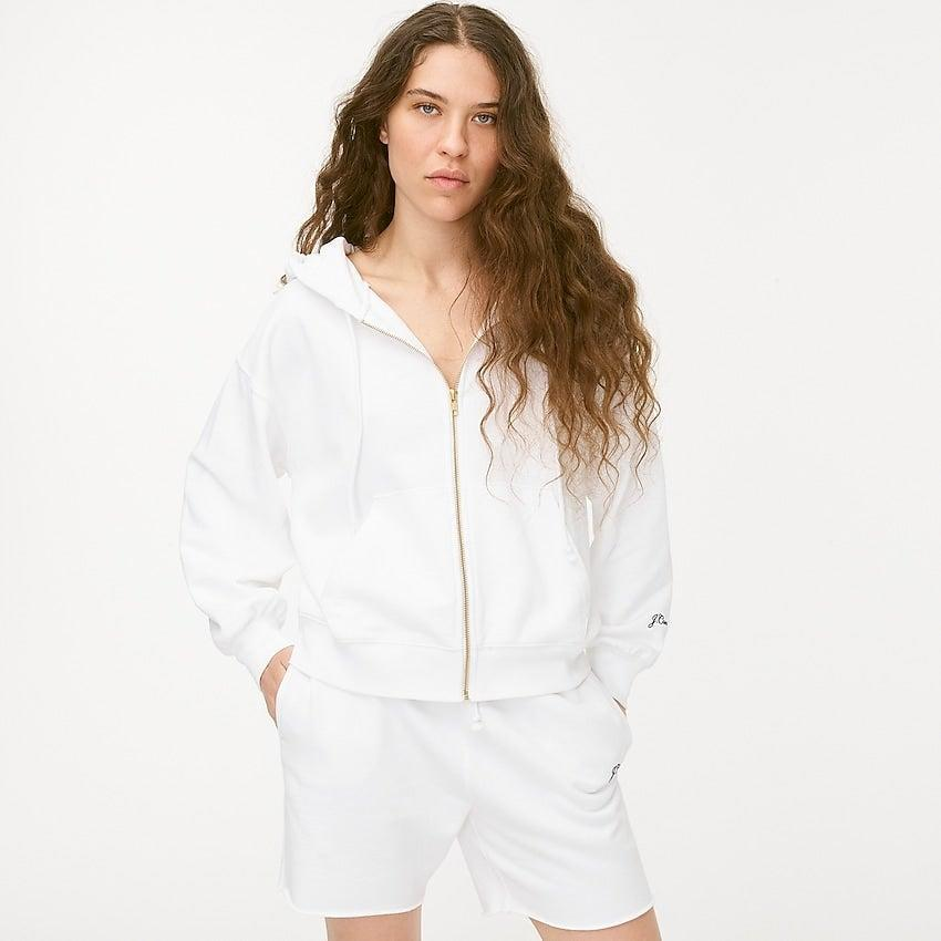 """<br><br><strong>J. Crew</strong> Original cotton terry zip-up hoodie with logo embroider, $, available at <a href=""""https://go.skimresources.com/?id=30283X879131&url=https%3A%2F%2Fwww.jcrew.com%2Fp%2Fwomens%2Fcategories%2Fclothing%2Fsweatshirts-and-sweatpants%2Fhoodies%2Foriginal-cotton-terry-zip-up-hoodie-with-logo-embroidery%2FAY442%3Fdisplay%3Dstandard%26fit%3DClassic%26color_name%3Dwhite%26colorProductCode%3DAY442"""" rel=""""nofollow noopener"""" target=""""_blank"""" data-ylk=""""slk:J. Crew"""" class=""""link rapid-noclick-resp"""">J. Crew</a>"""