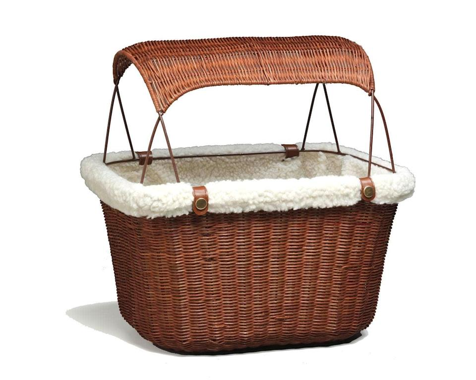 """<h3>PetSafe Bicycle Basket<br></h3> <br>If you've got a Toto-sized furry friend, then we suggest toting them around in this wicker basket complete with a woven sunshade — it's one seriously adorable way to keep your canine companion cool as you cruise through town. <br><br>The basket easily attaches to your handlebars and comes with a removable, washable liner. (FYI: if your doggo is more than 13 lbs, we recommend that you <a href=""""https://www.chewy.com/petsafe-happy-ride-pet-bicycle/dp/53730"""" rel=""""nofollow noopener"""" target=""""_blank"""" data-ylk=""""slk:opt for a trailer"""" class=""""link rapid-noclick-resp"""">opt for a trailer</a>.)<br><br><strong>PetSafe</strong> PetSafe Happy Ride Tagalong Wicker Bicycle Basket, $, available at <a href=""""https://go.skimresources.com/?id=30283X879131&url=https%3A%2F%2Fwww.petco.com%2Fshop%2Fen%2Fpetcostore%2Fproduct%2Fsolvit-tagalong-wicker-bicycle-basket-for-dogs-1310712"""" rel=""""nofollow noopener"""" target=""""_blank"""" data-ylk=""""slk:Petco"""" class=""""link rapid-noclick-resp"""">Petco</a><br><br><br>"""