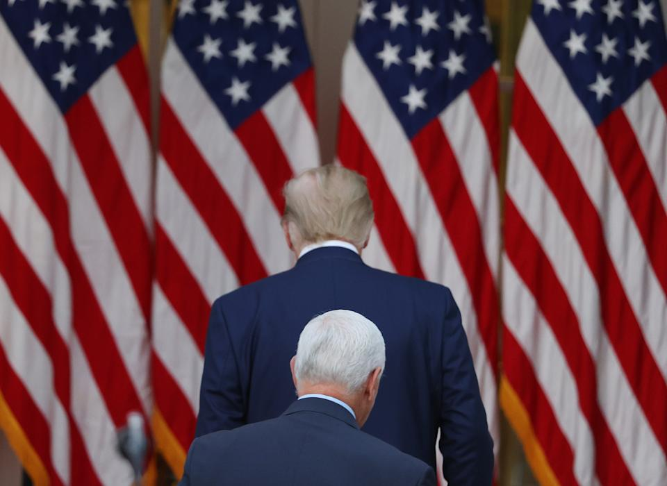 With Mike Pence in tow, the president exited without taking questions from the press. Source: Getty