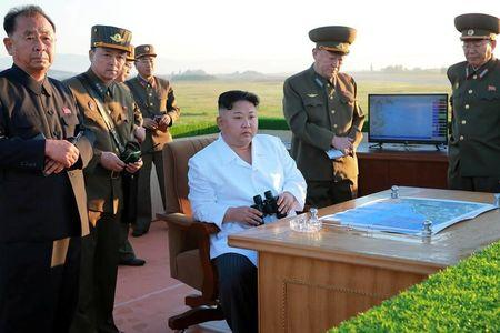 North Korean leader Kim Jong Un watches the test of a new-type anti-aircraft guided weapon system organised by the Academy of National Defence Science