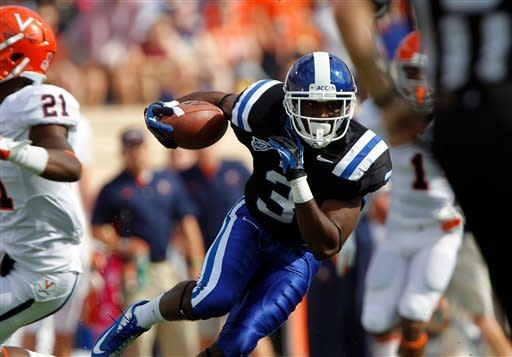 Duke wide receiver Jamison Crowder (3) runs for a touchdown past Virginia safety Brandon Phelps (21) during the first quarter of an ACC college football game in Durham N.C., on Saturday, Oct. 6, 2012. (AP Photo/The News & Observer, Chris Seward)