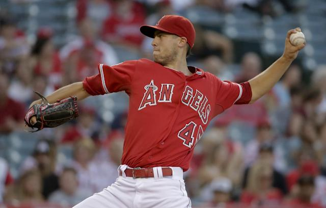 Los Angeles Angels starting pitcher Tyler Skaggs throws against the Detroit Tigers during the first inning of a baseball game in Anaheim, Calif., Friday, July 25, 2014. (AP Photo/Chris Carlson)