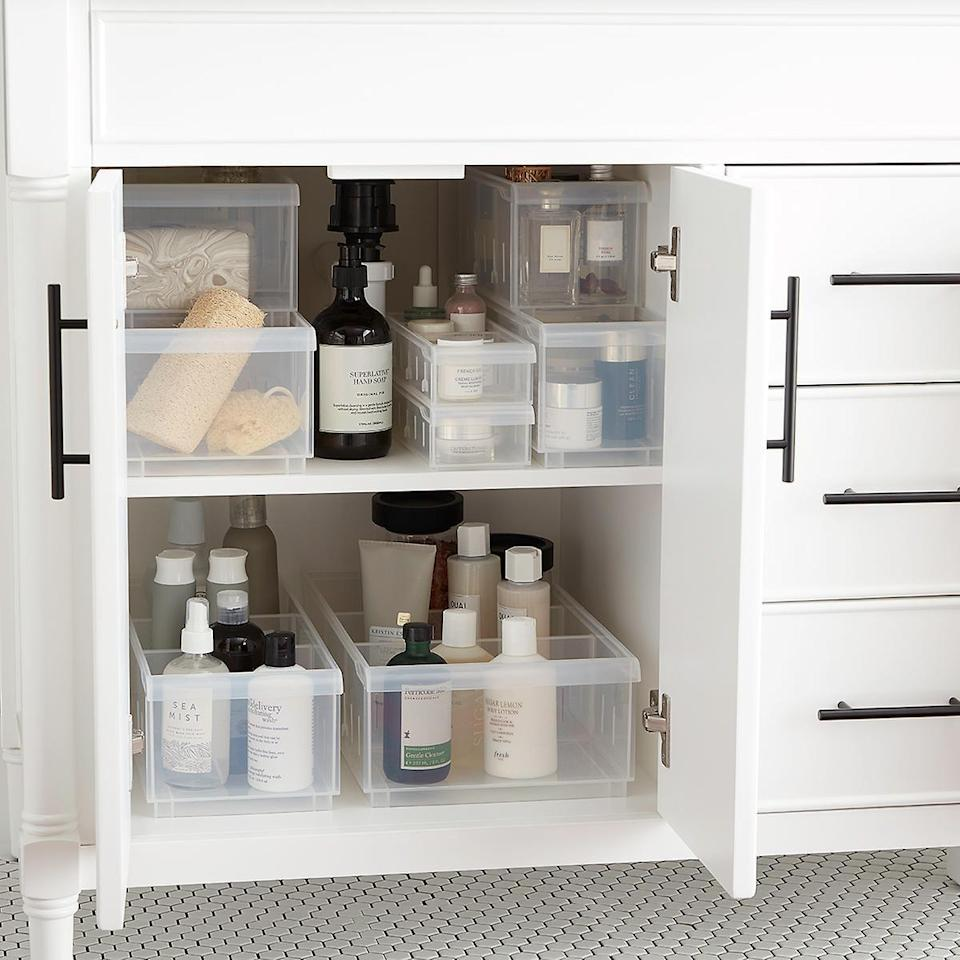 "<p>Fill your cabinet with these <a href=""https://www.popsugar.com/buy/Clear-Stackable-Plastic-Storage-Bins-474642?p_name=Clear%20Stackable%20Plastic%20Storage%20Bins&retailer=containerstore.com&pid=474642&price=2&evar1=casa%3Aus&evar9=47203882&evar98=https%3A%2F%2Fwww.popsugar.com%2Fhome%2Fphoto-gallery%2F47203882%2Fimage%2F47204175%2FClear-Stackable-Plastic-Storage-Bins&list1=shopping%2Corganization%2Csmall%20space%20living%2Cbathrooms%2Chome%20organization%2Chome%20shopping&prop13=mobile&pdata=1"" class=""link rapid-noclick-resp"" rel=""nofollow noopener"" target=""_blank"" data-ylk=""slk:Clear Stackable Plastic Storage Bins"">Clear Stackable Plastic Storage Bins</a> ($2-$15).</p>"