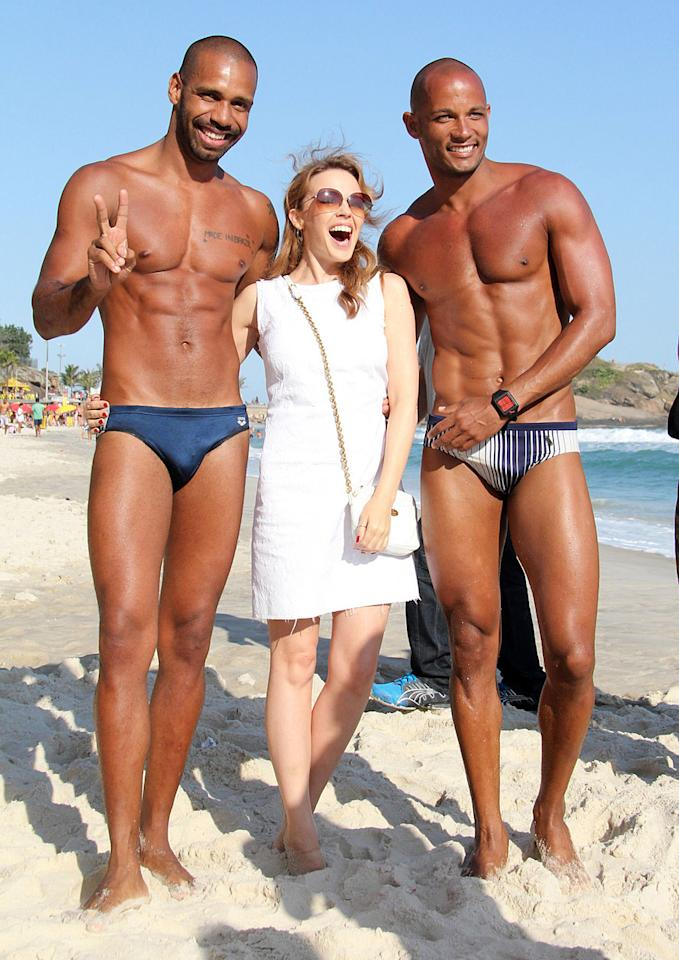 85011, RIO DE JANEIRO, BRAZIL - Wednesday October 3, 2012. Singer Kylie Minogue grabs lunch at Aprazível restaurant in Santa Tereza before heading to  Ipanema beach with friends to dip her feet in the sea, and pose with happy, muscular fans at the beach.  