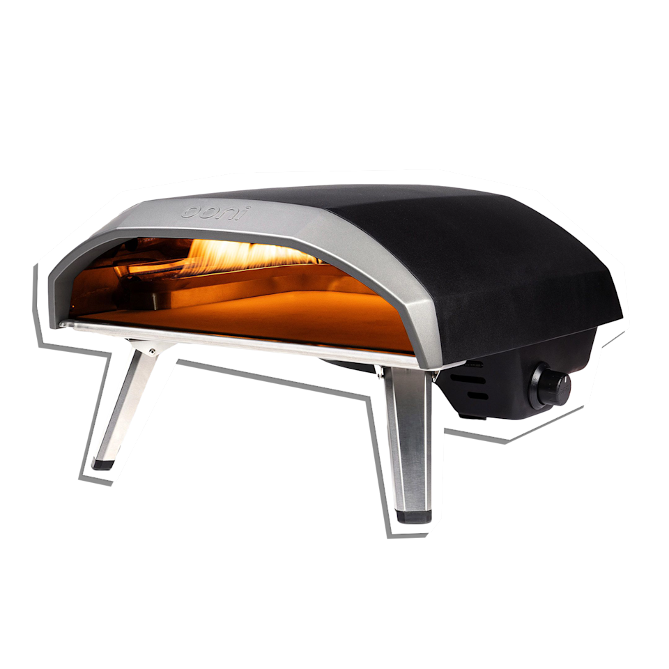 """Dad's backyard gatherings have never seen an apparatus this chic. In just 25 minutes this portable oven soars to 932 degrees, which will make the best homemade pie in 60 seconds flat. $499, Crate & Barrel. <a href=""""https://www.crateandbarrel.com/ooni-koda-16-pizza-oven/s196618"""" rel=""""nofollow noopener"""" target=""""_blank"""" data-ylk=""""slk:Get it now!"""" class=""""link rapid-noclick-resp"""">Get it now!</a>"""
