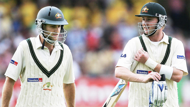Michael Clarke (pictured right) talking with with Simon Katich (pictured left) walking off the pitch.