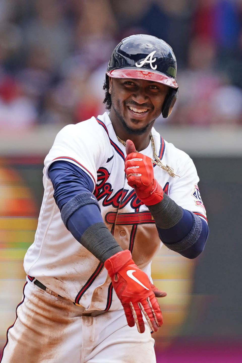 Atlanta Braves' Ozzie Albies (1) reacts after driving in a run with a double in the seventh inning of a baseball game against the Washington Nationals, Thursday, June 3, 2021, in Atlanta. (AP Photo/John Bazemore)