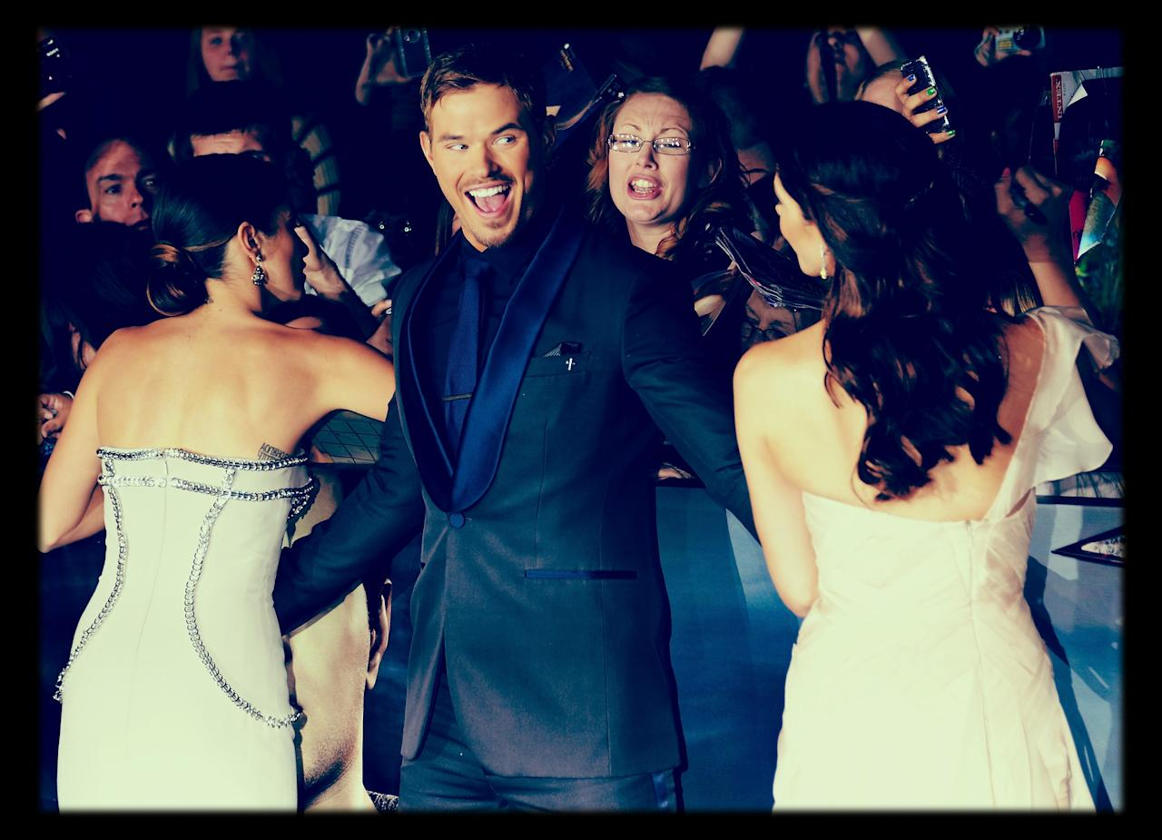 "LOS ANGELES, CA - NOVEMBER 12:  (EDITORS NOTE: Image was processed using Instagram Photoshop filter)  (L-R) Actress Nikki Reed, actor Kellan Lutz and actress Ashley Greene arrive at the Summit Entertainment's ""The Twilight Saga: Breaking Dawn - Part 2"" at Nokia Theatre L.A. Live on November 12, 2012 in Los Angeles, California.  (Photo by Michael Buckner/Getty Images)"
