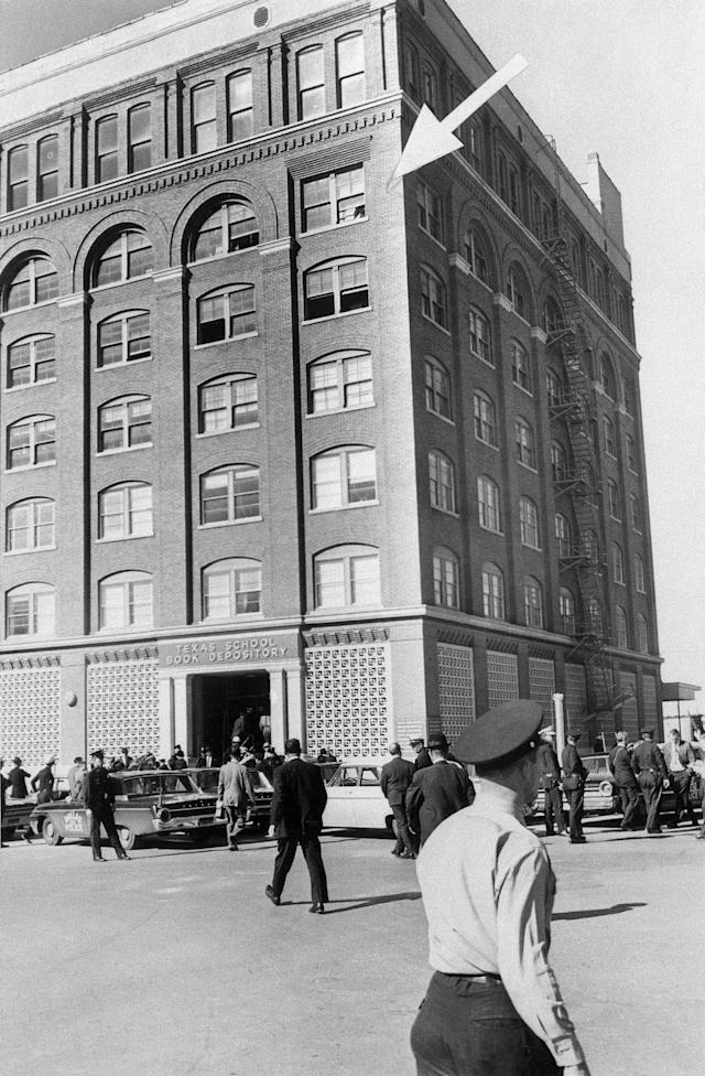 <p>An arrow points to the window where an assassin cut down President John F. Kennedy on Nov. 22, 1963, in Dallas. (Photo: Bettmann/Getty Images) </p>