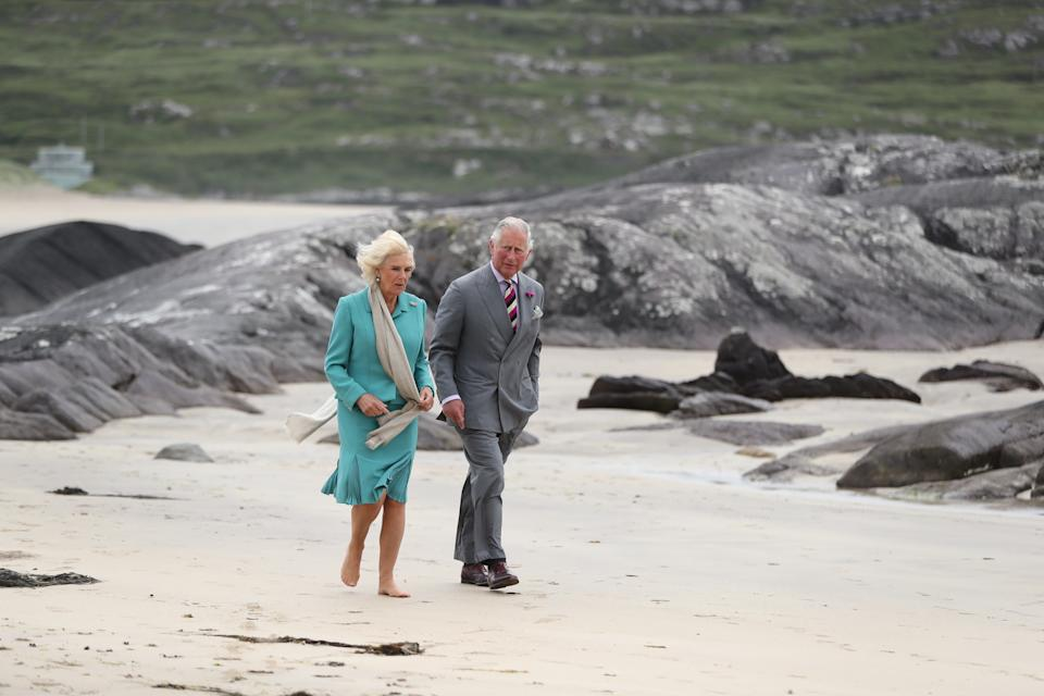 DERRYNANE, IRELAND - JUNE 15: Prince Charles, Prince of Wales and Camilla, Duchess of Cornwall walk on Derrynane beach in Co Kerry during thier tour of Northern Ireland and the Republic of Ireland on June 15, 2018 in Derrynane, Ireland. (Photo by Niall Carson - WPA Pool/Getty Images)