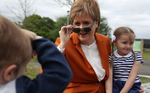 <span>First Minister Nicola Sturgeon with Brody Downs (left) and Darci Kerr from Bridgeton family centre visiting the Cuningar Loop as she announced new investment for the Clyde Gateway regeneration programme</span> <span>Credit: PA </span>