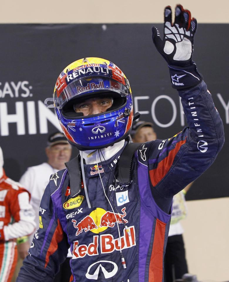 Red Bull Formula One driver Mark Webber of Australia waves after taking pole position during the qualifying session of the Abu Dhabi F1 Grand Prix at the Yas Marina circuit on Yas Island, November 2, 2013. Webber put Red Bull on pole position for the floodlit Abu Dhabi Formula One Grand Prix on Saturday in a front row sweep with quadruple world champion team mate Sebastian Vettel. REUTERS/Caren Firouz (UNITED ARAB EMIRATES - Tags: SPORT MOTORSPORT F1)