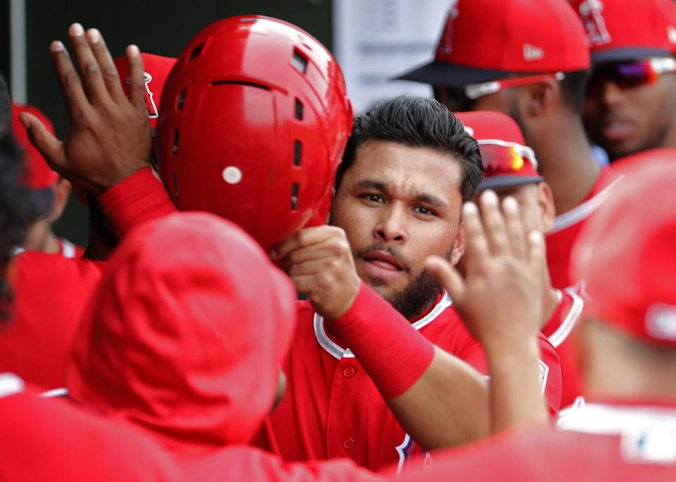 Angels infielder Jose Rojas is congratulated by teammates after scoring.