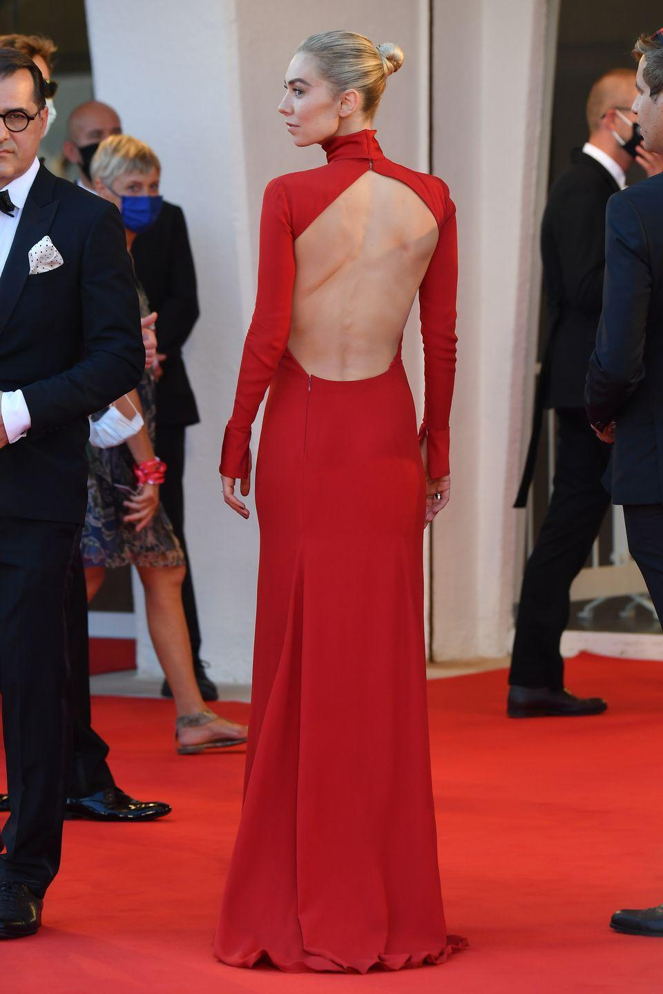 """<p>Kirby stunned in a red backless gown for the Venice Film Festival premiere of <em>Pieces of a Woman; </em>she earned <a href=""""https://www.indiewire.com/2020/09/venice-film-festival-2020-winners-list-1234585982/"""" rel=""""nofollow noopener"""" target=""""_blank"""" data-ylk=""""slk:the festival's Best Actress award"""" class=""""link rapid-noclick-resp"""">the festival's Best Actress award</a> for her role in the project.</p>"""