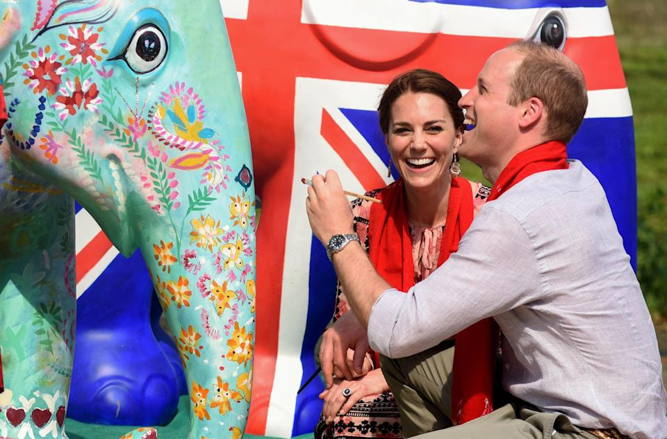 <p>During the Duke and Duchess of Cambridge's week-long trip to India and Bhutan in April 2016, the couple also showed their artistic side by helping to paint a statue elephant with locals. <em>[Photo: Getty]</em> </p>