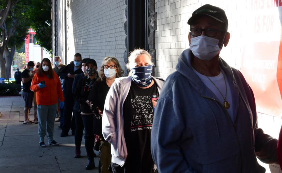 People wait in line for entry to Covid-19 antibody testing offered for free at the Destiny Community Church International in Whittier, California on January 13, 2021. - The post-holiday surge is shaping up across California some two weeks into the new year as Covid-19 deaths continue to rise in Los Angeles County. (Photo by Frederic J. BROWN / AFP) (Photo by FREDERIC J. BROWN/AFP via Getty Images)
