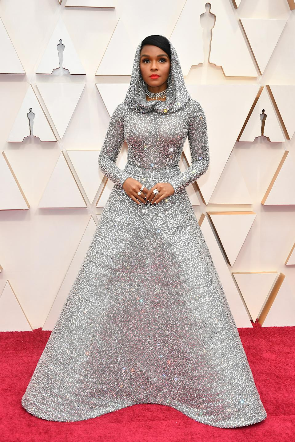 The actress and singer arrived on the red carpet in a dazzling silver gown by Ralph Lauren.