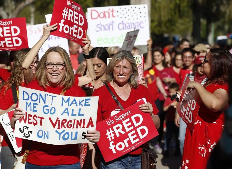 Teachers and advocates for public education march at the Arizona Capitol