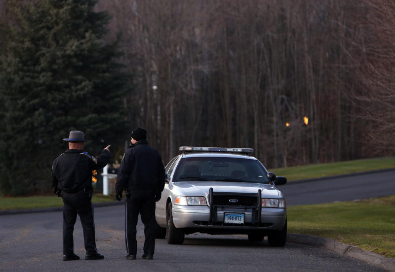 Police block off a section of Yogananda Street near a house belonging to the mother of a man who opened fire inside a Connecticut elementary school, killing 26 people, including 18 children, Friday, Dec. 14, 2012 in Sandy Hook, Conn.  (AP Photo/Jason DeCrow)
