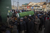 Kashmiri Muslims carry the coffin of Basharat Ahmad Zargar in Srinagar, Indian-controlled Kashmir, Sunday, Feb.14, 2021. Zargar, who was working at a power project, was among the dozens killed after a part of a Himalayan glacier broke off on February 7 sending a devastating flood downriver slamming into two hydropower projects in northern India. (AP Photo/Mukhtar Khan)