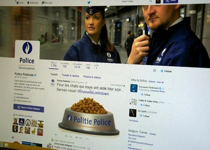 The twitter account of the Belgian federal police with a post offering a virtual bowl of pet food to thank social media users for agreeing to pause their posts about the major anti-terrorism operation in Brussels and posting images of cats instead (AFP Photo/Philippe Francois)