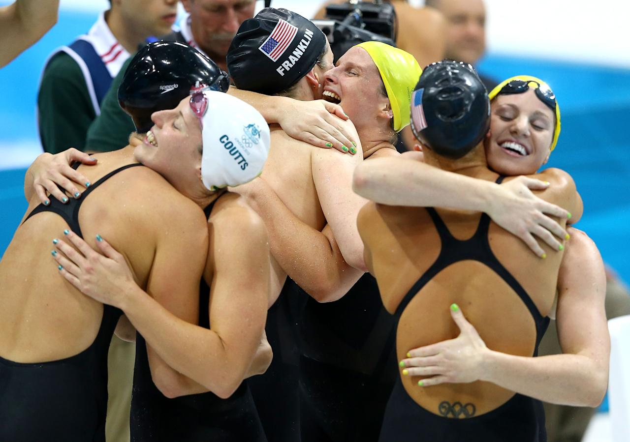LONDON, ENGLAND - AUGUST 04:  Dana Vollmer of the United States, Alicia Coutts of Australia, Missy Franklin of the United States, Leisel Jones of Australia, Allison Schmitt of the United States and Emily Seebohm of Australia congratulate each other following the Women's 4x100m Medley Relay on Day 8 of the London 2012 Olympic Games at the Aquatics Centre on August 4, 2012 in London, England.  (Photo by Al Bello/Getty Images)