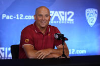 FILE - In this July 27, 2021, file photo, Southern California head coach Clay Helton answers questions during the Pac-12 Conference NCAA college football media day in Los Angeles. For the sixth consecutive summer, Clay Helton is back for another shot at restoring Southern California to an annual spot among college football's national title contenders. (AP Photo/Marcio Jose Sanchez, File)
