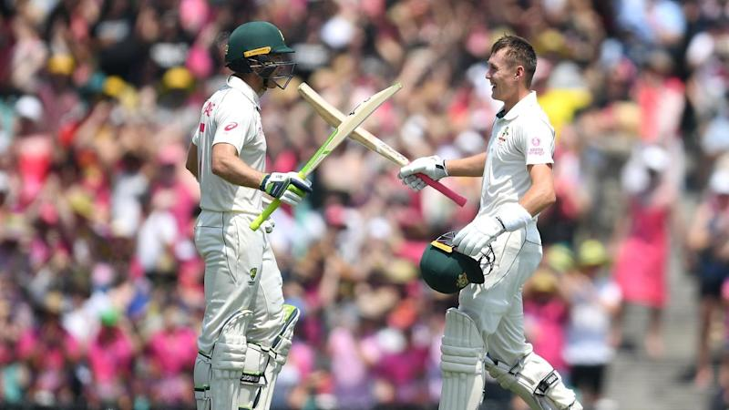 Marnus Labuschagne (R) is congratulated by Tim Paine (L) after scoring his maiden double century