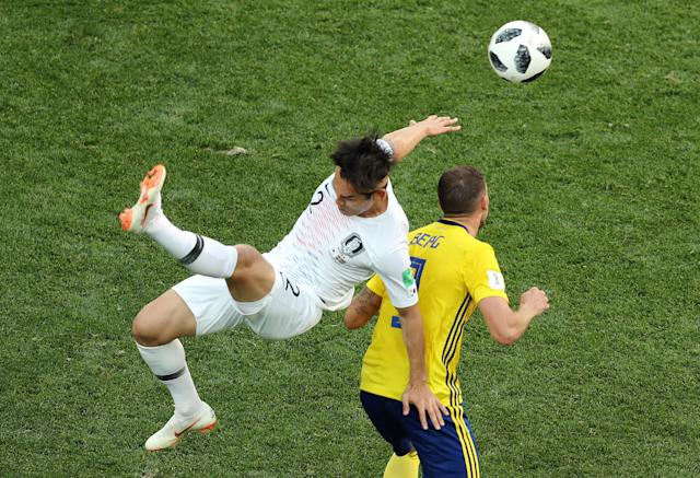 Soccer Football - World Cup - Group F - Sweden vs South Korea - Nizhny Novgorod Stadium, Nizhny Novgorod, Russia - June 18, 2018 South Korea's Lee Yong in action with Sweden's Marcus Berg REUTERS/Lucy Nicholson
