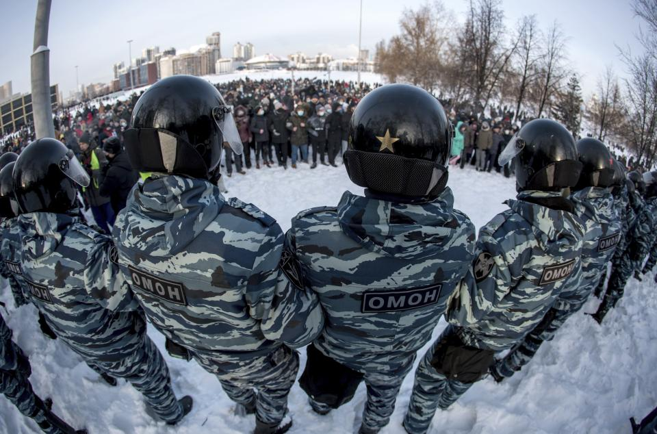 FILE - In this Jan. 23, 2021, file photo, police block a protest against the jailing of opposition leader Alexei Navalny in Yekaterinburg, Russia. Allies of Navalny are calling for new protests next weekend to demand his release, following a wave of demonstrations across the country that brought out tens of thousands in a defiant challenge to President Vladimir Putin. (AP Photo/Anton Basanayev, File)