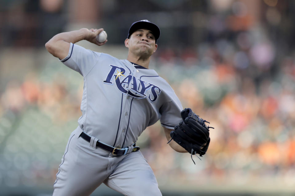 Tampa Bay Rays starting pitcher Yonny Chirinos throws to a Baltimore Orioles batter during the first inning of a baseball game Friday, July 12, 2019, in Baltimore. (AP Photo/Julio Cortez)
