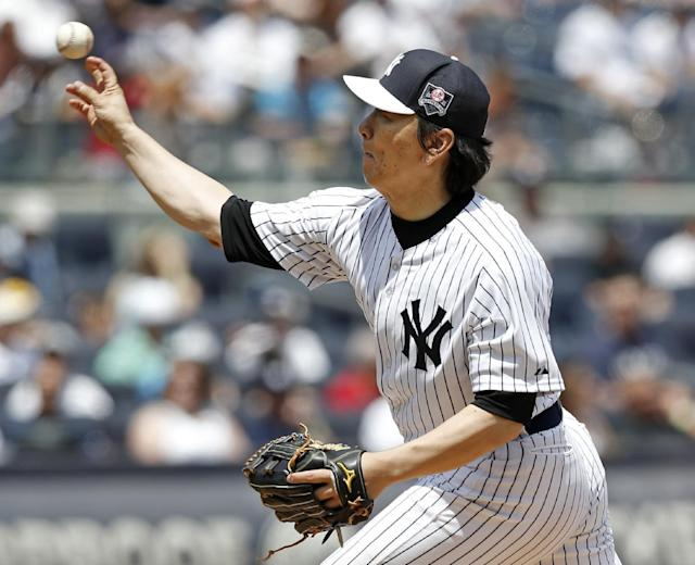New York Yankees World Series MVP Hideki Matsui delivers a pitch during the 68th Annual Old Timers' Day before the Baltimore Orioles baseball game against the Yankees at Yankee Stadium in New York, Sunday, June 22, 2014. (AP Photo/Kathy Willens)