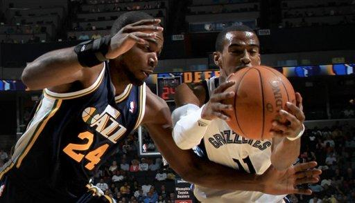Memphis Grizzlies guard Mike Conley (11) grabs a rebound away from Utah Jazz forward Paul Millsap (24) in the first half of an NBA basketball game on Saturday, April 14, 2012, in Memphis, Tenn. (AP Photo/Nikki Boertman)
