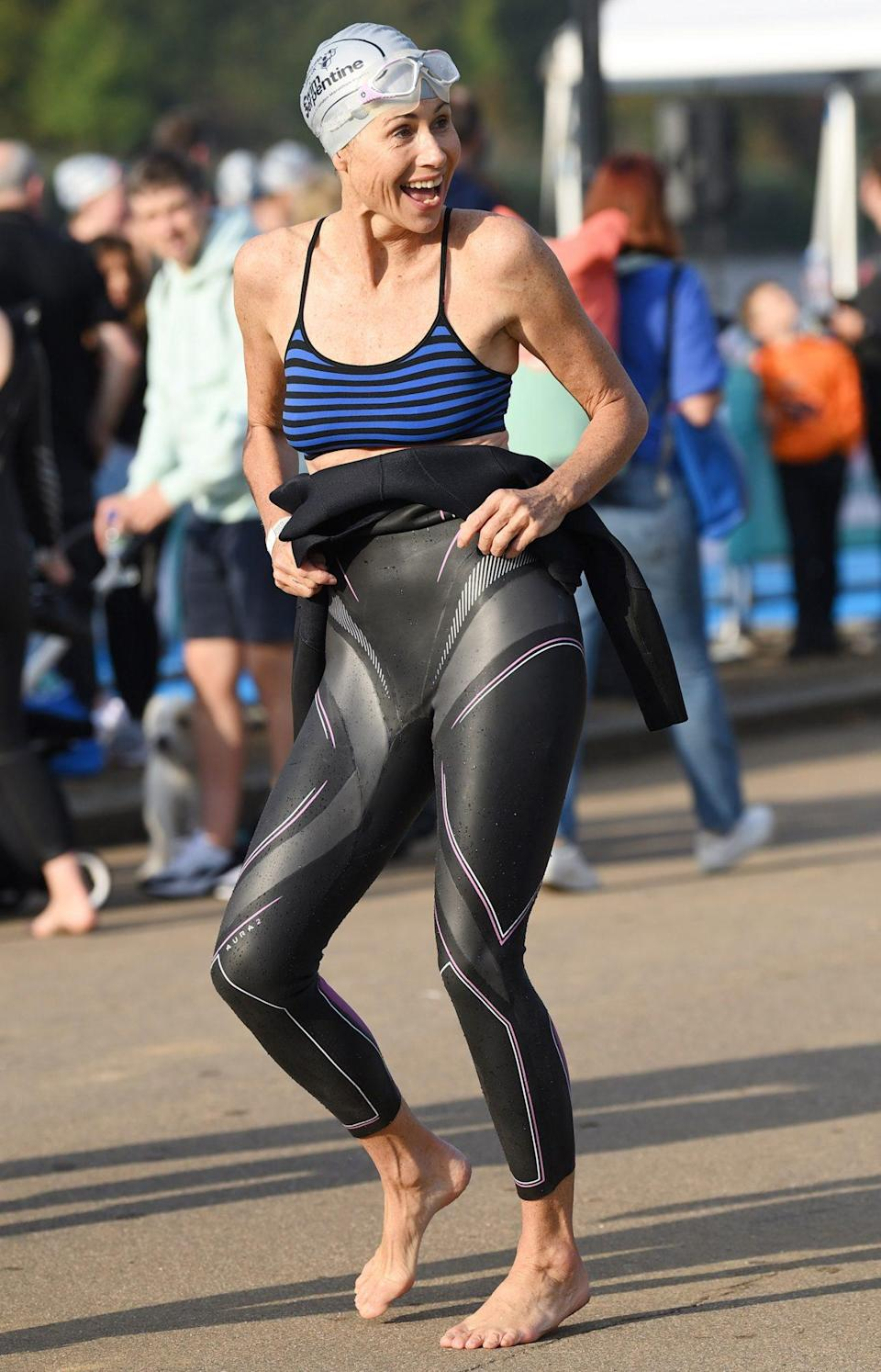 <p>Minnie Driver suits up on Sept. 18 while preparing to go for a dip at the Children with Cancer UK Swim Serpentine in London's Hyde Park.</p>